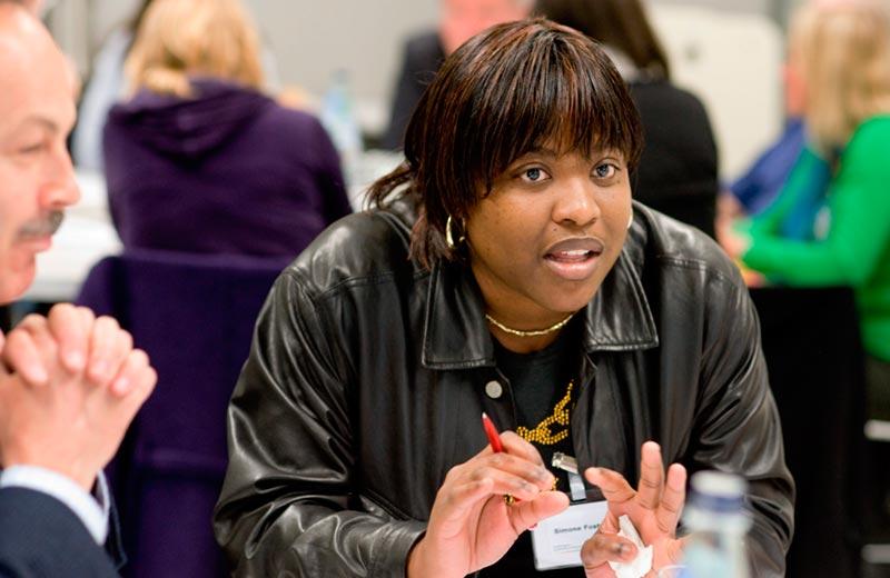 woman at a meeting talking