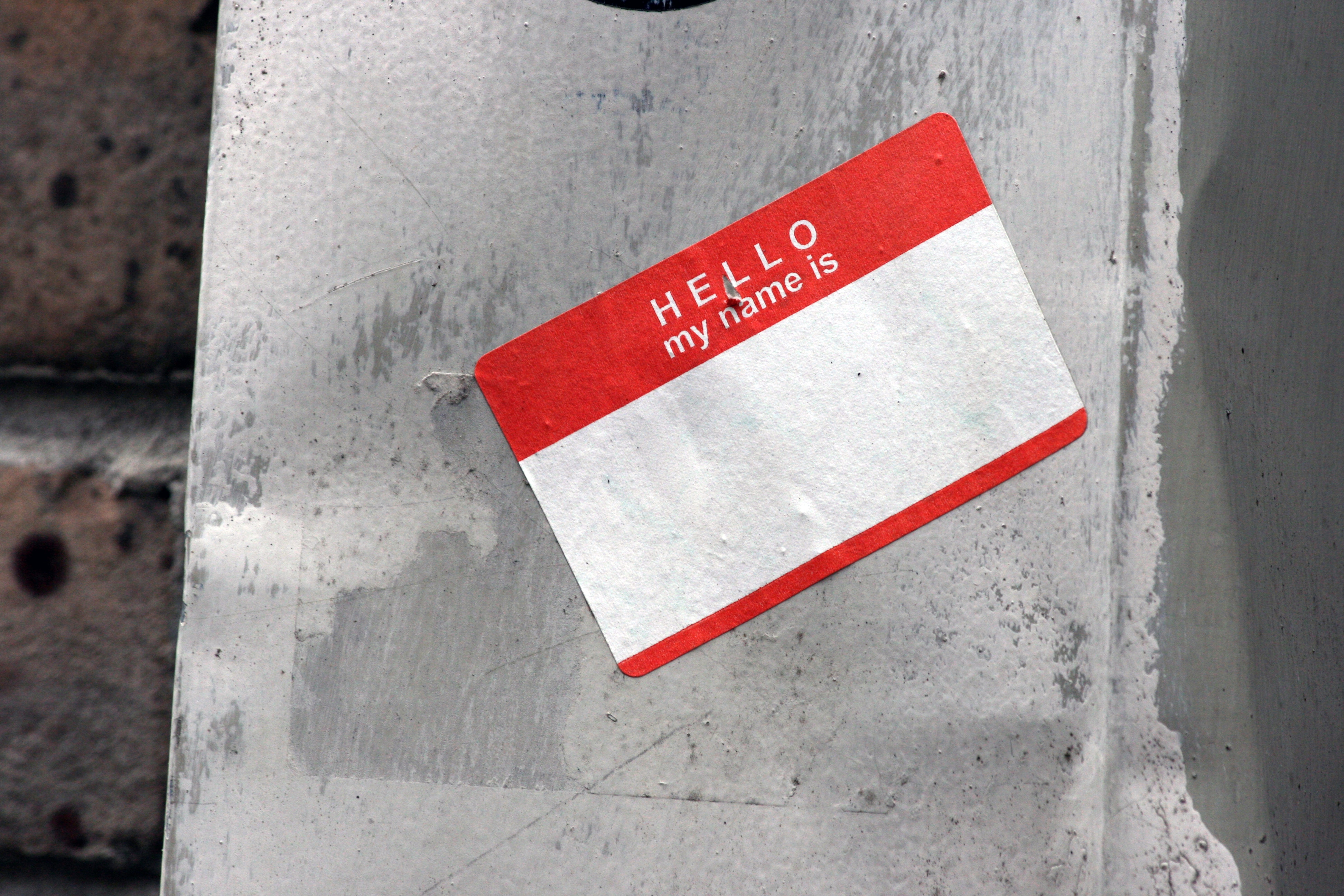 A 'hello my name is...' label stuck to a wall